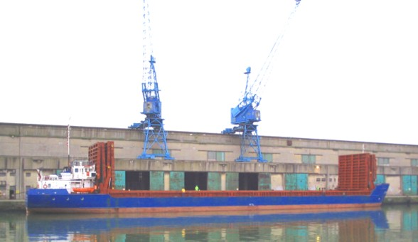 vessel unloading timber at liverpool docks